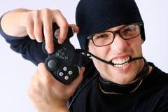 Boy eats joystick Royalty Free Stock Photography