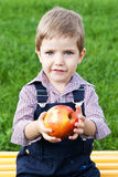 Boy eats in the park Royalty Free Stock Photo
