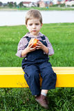 Boy eats in the park Stock Photo