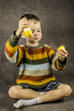 Boy eats a pear Royalty Free Stock Photography