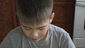 The boy eats an  tasty melon stock video footage