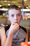 Boy eats thoughtfully Royalty Free Stock Images