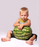 The boy eats a water-melon Royalty Free Stock Photography
