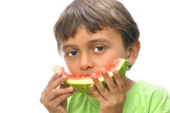 Boy eats watermelon Stock Photos