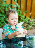 Boy Eats a White Chocolate Bunny Stock Photo
