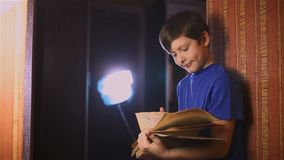 Boy education teen reading book is wall indoor stock video footage