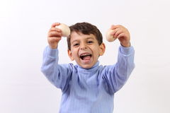 Boy and egg Stock Images
