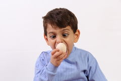 Boy and egg Royalty Free Stock Images