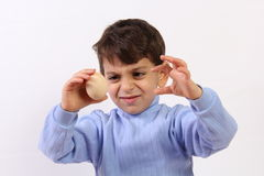 Boy and egg Stock Photography