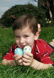 Boy with eggs 11. A young boy holding two Easter eggs stock photos