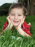 Boy with eggs 2. A young boy smiling while leaning over decorated Easter eggs royalty free stock photo