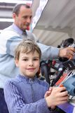 Boy with elderly man in shop of electrotools Royalty Free Stock Photos