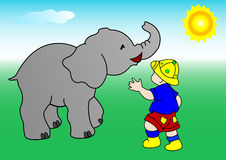The boy and the elephant Stock Image