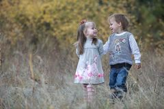 Boy embraces girl. Little boy gently hugs her little sister stock photos