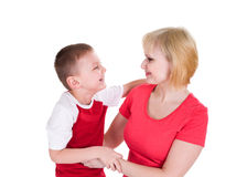 The boy embraces mother and cheerfully laughs Royalty Free Stock Photos