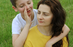 Boy embracing his mother Stock Photo