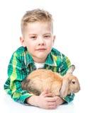 Boy embracing rabbit. Isolated on white background Stock Images
