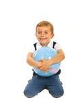Boy embracing world globe Stock Photography