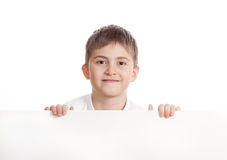 Boy emerge from behind poster Royalty Free Stock Image
