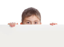 Boy emerge from behind poster Stock Images
