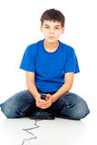 Boy emotionally plays on the joystick Stock Photo