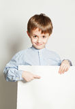 Boy and empty billboard Royalty Free Stock Photo