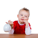 Boy with an empty cup Stock Image