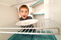 Boy and Empty Refrigerator Stock Photography