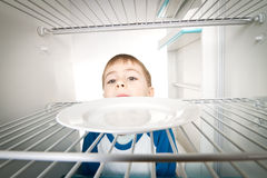 Boy and Empty Refrigerator Royalty Free Stock Photos