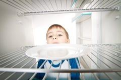 Boy and Empty Refrigerator Royalty Free Stock Photos