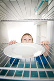 Boy and Empty Refrigerator Royalty Free Stock Image
