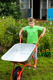 Boy with the empty wheelbarrow Royalty Free Stock Images