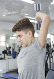 Boy engaged in the gym hall. Teenage boy engaged in the gym hall Royalty Free Stock Image