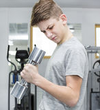 Boy engaged in the gym hall Stock Photos