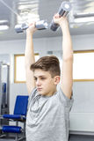 Boy engaged in the gym hall. Teenage boy engaged in the gym hall Royalty Free Stock Images