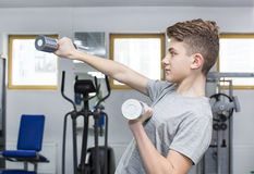 Boy engaged in the gym hall Stock Photo