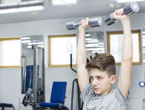 Boy engaged in the gym hall. Teenage boy engaged in the gym hall Stock Photography