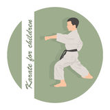The boy is engaged in karate on a green background Royalty Free Stock Image