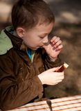 Boy enjoing the bread and butter on the open air Stock Image