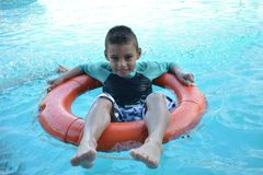 Boy enjoing pool day. Pool day kid Stock Photography
