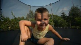 Boy enjoy jumping on trampoline stock video footage