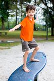 Boy enjoying balancing beam Royalty Free Stock Photos