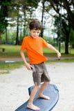 Boy enjoying balancing beam Stock Image