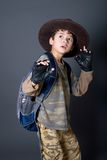 Boy enjoying becoming a famous movie character. Royalty Free Stock Image