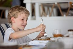 Boy enjoying breakfast royalty free stock photography