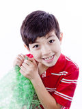 Boy enjoying bubble wrap. Stock Photography