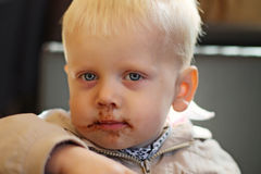 A boy enjoying cookie Stock Photography