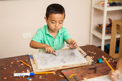 Boy enjoying his art class at school Royalty Free Stock Images