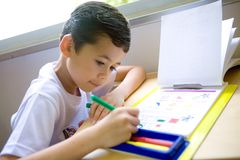Boy enjoying his coloring book Stock Photography