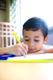 Boy enjoying his coloring book Royalty Free Stock Photos